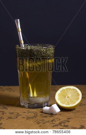 Still-life Of  A Glass Of Tea, Sugar Cubes And A Slice Of Lemon