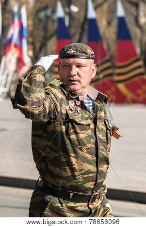 Army captain salutes on Victory Day parade