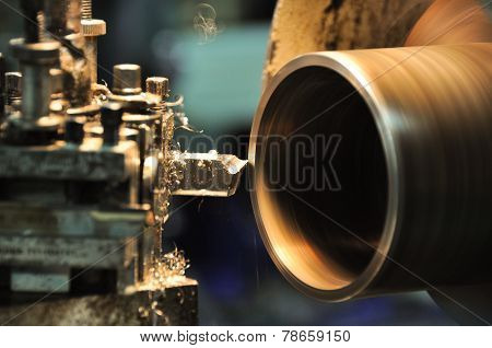 lathe machine in a workshop, Part of the lathe. Lathe machine is operation on the work shop.