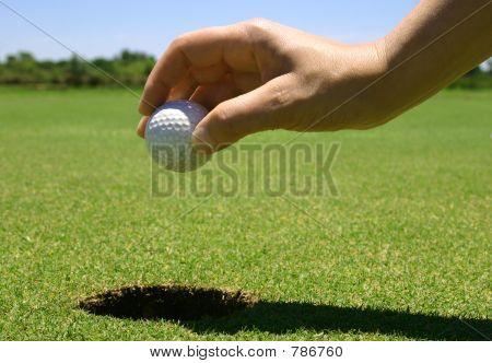 Picking u p the golf ball