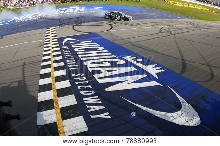 Brooklyn, MI - Jun 15, 2014:  Jimmie Johnson (48) wins the