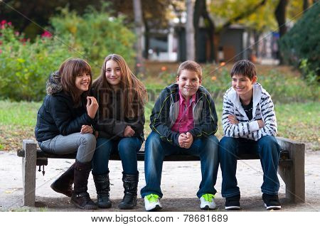 Four Teenage Friends Having Fun In The Park
