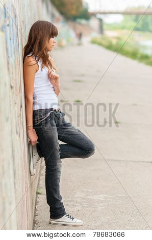 Lonely teenage girl in urban environment
