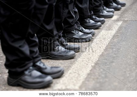 Black Military Boots In A Row