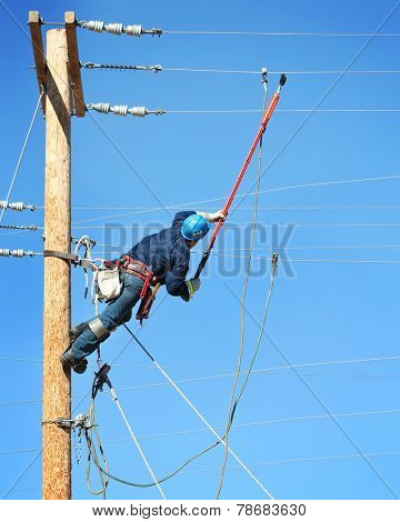 an electrical lineman student working on a pole at a lineman college poster