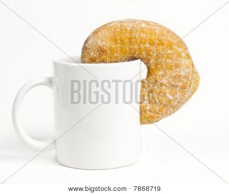 Coffee cup and fresh baked doughnut