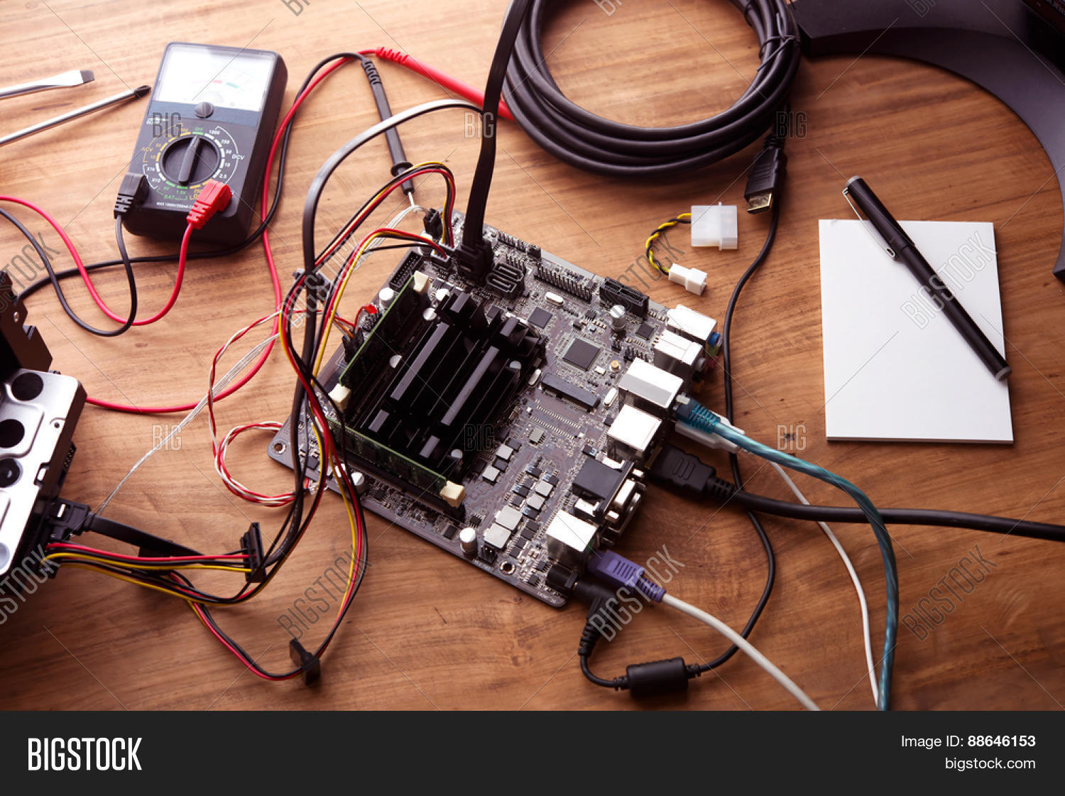 Electronic project prototype making image photo bigstock electronic project or prototype making bare computer circuit board hooked up on a work table greentooth Image collections