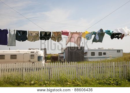 Trailer homes and laundry drying on line in North Rustico, Prince Edward Island, Canada.