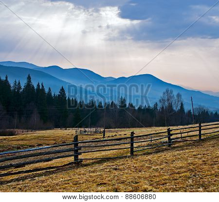 Rural landscape and the mountains on the background