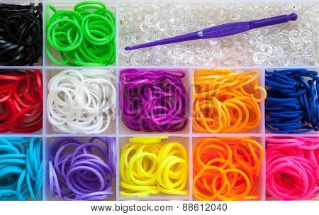Colorful of elastic rainbow loom bands for needlework poster