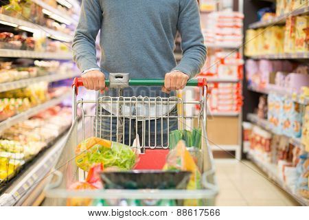 Closeup detail of a man shopping in a supermarket