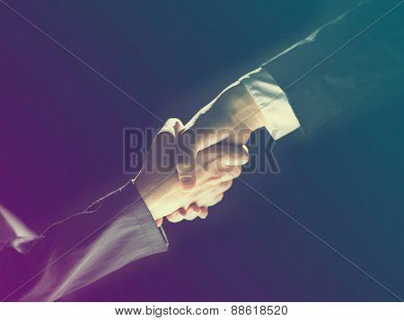 Handshake Handshaking light and dark