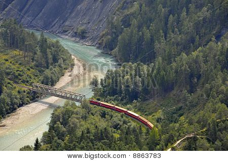Train over a river bridge