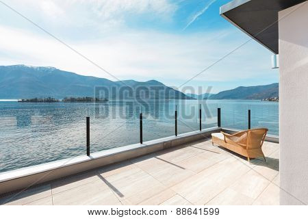 modern architecture, beautiful lake view from the terrace of a penthouse poster
