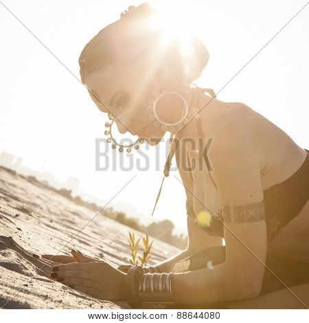 Girl in the desert with sand