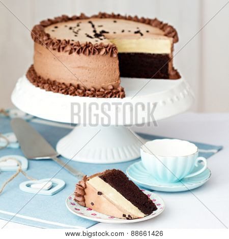 Chocolate layer cake on a cake stand