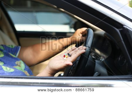 Women Taking Pills Inside His Car