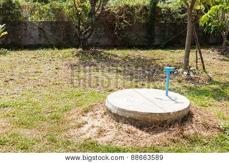 underground cement cylinder of lavatory cesspit in lawn yard poster