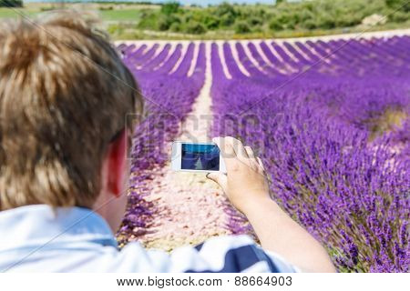 Man Making Picure With Mobile Phone Of Lavender Field