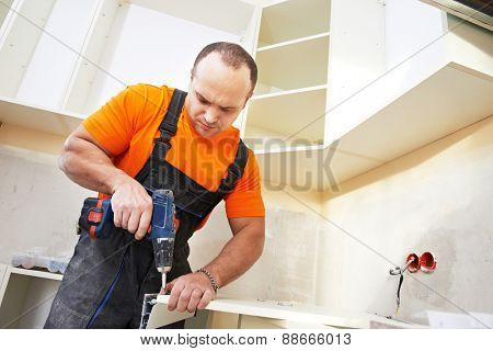 Craftsman kitchen carpenter at kitchen furniture set installation service work poster