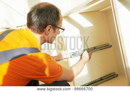 Craftsman kitchen carpenter at kitchen cabinet installation service work poster