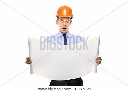 Surprised Construction Worker Looking At Project Papers