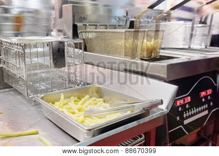 French fries on a metal tray