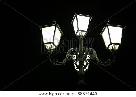 street lamp on a black sky
