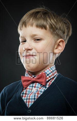 Close Up Portrait Of Smug Boy