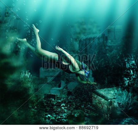 Woman Swimming Underwater. Adventure