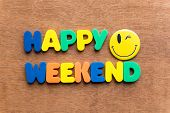 happy weekend colorful word on the wooden background poster
