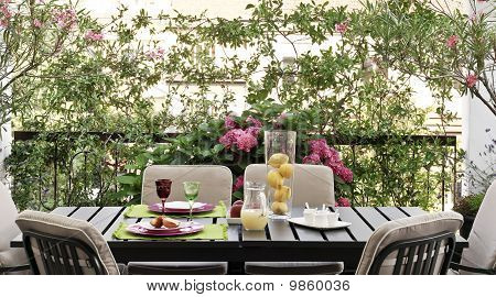 table set with dishes of fresh fruit on the terrace