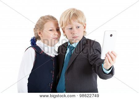 Cute Elementary Pupils Making Selfie Picture With Smartphone Together, Isolated On White Background