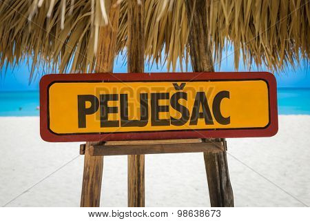 Peljesac sign with beach background