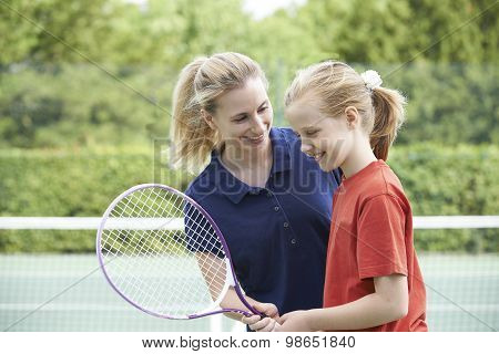 Female Tennis Coach Giving Lesson To Girl poster