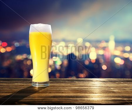 fresh  unfiltered beer and blured lighhts of Hong Kong