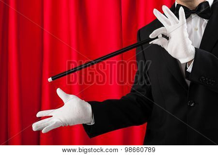 Close-up Of Magician Showing Trick