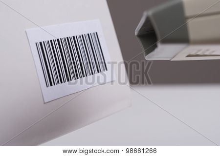 Person Hand Using A Barcode Scanner
