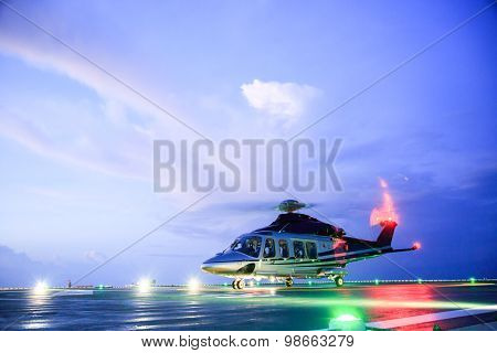 helicopter parking landing on offshore platform. Helicopter transfer crews or passenger to work