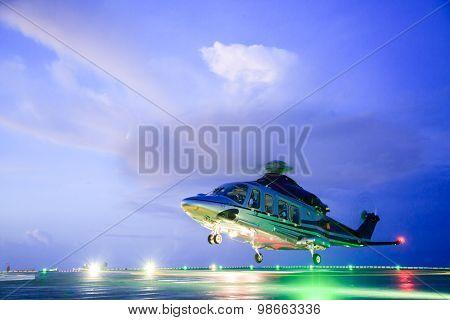 helicopter parking landing on offshore platform. Helicopter transfer crews or passenger to work