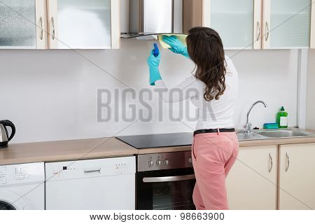 Woman Cleaning Cooker Hood With Rag