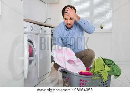 Man With Laundry Basket Holding Stained Cloth
