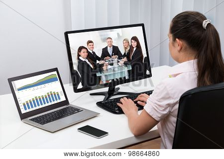 Businesswoman Videoconferencing On Computers