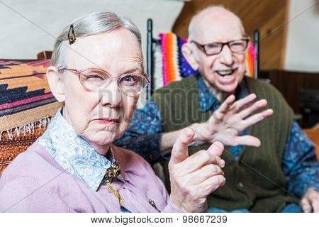 Angry Old Couple In Livingroom