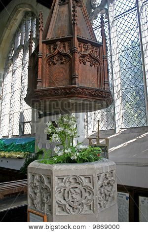old wooden font in church in Salisbury poster