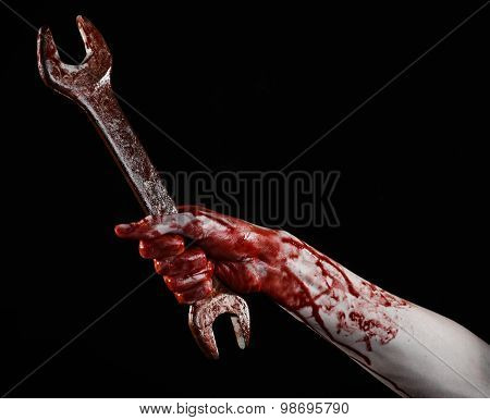 bloody hand holding a big wrench bloody wrench big key bloody theme halloween theme crazy mechanic murderer psycho violence zombies black background isolated revolution studio poster