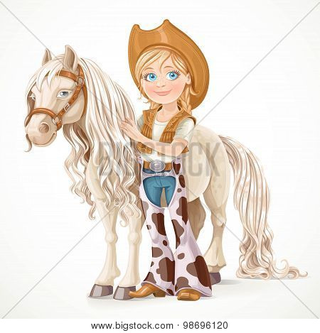 Cute Girl Dressed As A Cowboy Holds The Reins Saddled Horse Isol