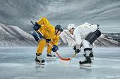 Ice hockey player on the ice in mountains poster