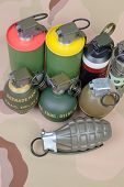 All explosives weapon armystandard time fuze hand grenade on camouflage background top view poster