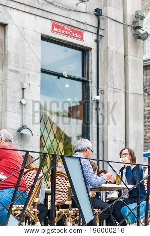 Montreal, Canada - May 27, 2017: Old Town Area With People Sitting Eating Food And Enjoying Atmosphe
